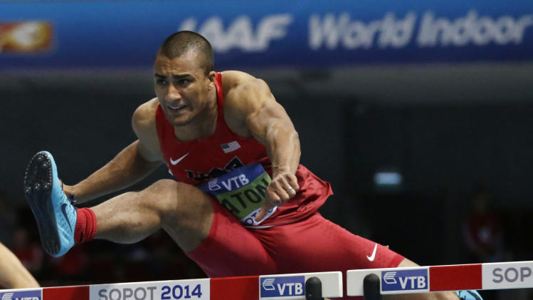 United States' Ashton Eaton clears a hurdle in the 60m hurdles of the men's heptathlon during the Athletics Indoor World Championships in Sopot, Poland, Saturday, March 8, 2014. (AP Photo/Matt Dunham)