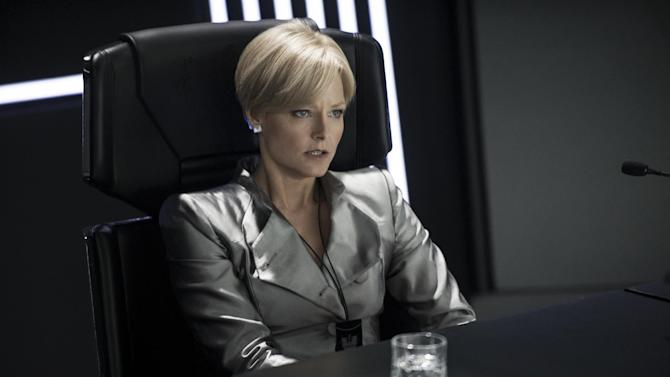 """This publicity photo released by Columbia TriStar Marketing Group, shows Jodie Foster as Secretary Delacourt in the CCB HQ Briefing Room being demoted in a scene from the film, """"Elysium."""" (AP Photo/Columbia TriStar Marketing Group, Kimberley French)"""