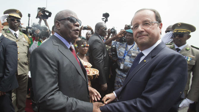 Mali's new president Ibrahim Boubacar Keita, left, welcomes France's President Francois Hollande, right, at Bamako airport, Mali, Thursday, Sept. 19, 2013. World leaders and politicians from various countries are in Bamako to attend the ceremony as Boubacar Keita is inaugurated as Mali's president. Hollande declared Thursday that the war on terror had been won in the West African nation of Mali, listing the towns that French and Malian troops liberated from al-Qaida's local fighters earlier this year. (AP Photo/Michel Euler, Pool)