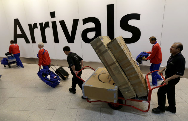 Members of the Cuban Olympic team arrive at London's Heathrow Airport Monday, July 16, 2012 as London prepares for the 2012 Summer Olympics. (AP Photo/Charlie Riedel)