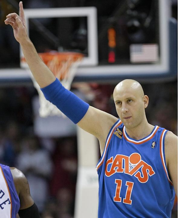 In this Dec. 2, 2009, file photo, Cleveland Cavaliers' Zydrunas Ilgauskas, of Lithuania, acknowledges the crowd while entering an NBA basketball game against the Phoenix Suns in Cleveland. Ilgausk