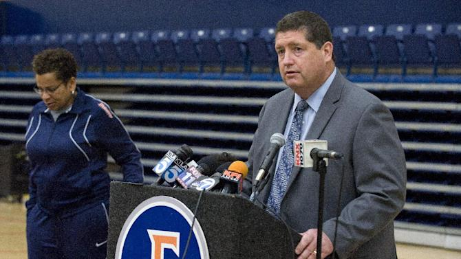 Cal State Fullerton athletics director Jim Donovan speaks as women's basketball coach Marcia Foster listens during a brief news conference about the death of assistant coach Monica Quan, Monday, Feb. 4, 2013, in Fullerton, Calif. Quan 28, and her fiance, Keith Lawrence, 27, were found shot to death on the top floor of a parking structure at their condominium complex Sunday, police said. (AP Photo/The Orange County Register, Bruce Chambers) MAGS OUT  LOS ANGELES TIMES OUT