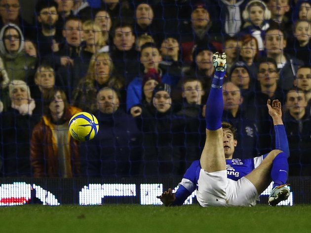 Everton's Jelavic reacts after being fouled for a penalty during their FA Cup fifth round replay soccer match against Oldham Athletic at Goodison Park in Liverpool