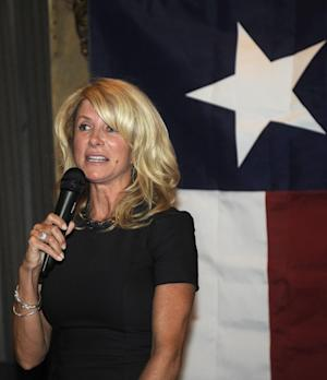 File - In this July 25, 2013 file photo, Democrat Texas State Senator Wendy Davis speaks at a fundraiser, Thursday, July 25, 2013, in Washington. Two people with knowledge of the decision say Davis will run for Texas governor. (AP Photo/Nick Wass, File)