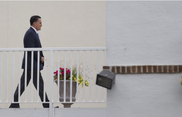 Republican presidential candidate, former Massachusetts Gov. Mitt Romney walks into a fundraising event on Thursday, Aug. 23, 2012 in Minnetonka Beach, Minn. (AP Photo/Evan Vucci)