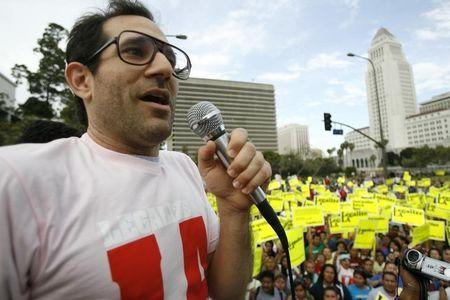 American Apparel owner Dov Charney speaks during a May Day rally protest march for immigrant rights, in downtown Los Angeles