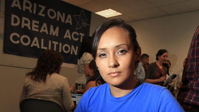 FILE - In this Aug. 15, 2012 file photo, young immigrant Erika Andiola, of Mesa, Ariz., poses for a portrait at a site where people line up to get guidance on a new federal program, called Deferred Action, that would help them avoid deportation in Phoenix, Arizona. The mother and a brother of Andiola were arrested Thursday evening, Jan. 10, 2013 at the family's Phoenix-area home. Andiola says ICE agents said there was a long-pending deportation order for her mother.  The brother was released early Friday, Jan. 11, 2013, while the mother was transported to an immigration detention center in Florence. Another brother says the family has been told by the Mexican consulate in Mexico that the mother would be released after being returned to Phoenix. (AP Photo/Ross D. Franklin, File)