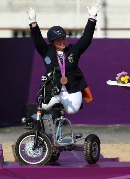 Angelika Trabert of Germany celebrates taking bronze in the Dressage Individual Freestyle Test, Grade II in the Equestrain on day 5 of the London 2012 Paralympic Games at Greenwich Park on September 3, 2012 in London, England. (Photo by Julian Finney/Getty Images)
