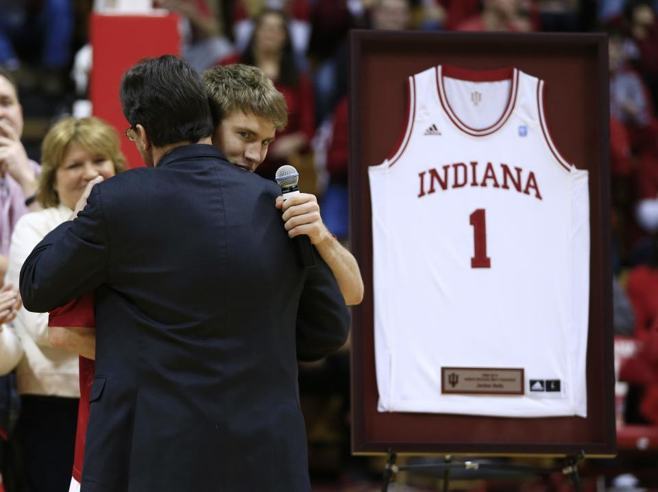 Indiana head coach Tom Crean hugs senior Jordan Hulls after Crean introduced Hulls on senior night following an NCAA college basketball game against Ohio State Wednesday, March 6, 2013, in Bloomington, Ind. Ohio State defeated Indiana 67-58. (AP Photo/Darron Cummings)