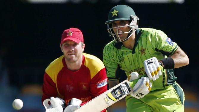 Zimbabwe's wicketkeeper Brendan Taylor watches Pakistan's captain Misbah-ul-Haq play a shot during their Cricket World Cup match in Brisbane