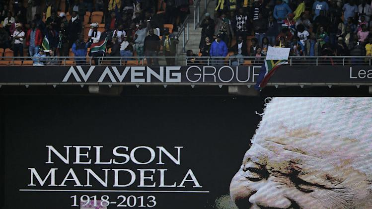 An image of former South African president Nelson Mandela is projected on a screen at the FNB Stadium in Soweto, near Johannesburg, South Africa, ahead of his memorial service Tuesday Dec. 10, 2013. Mandela died on Thursday Dec. 5, aged 95. (AP Photo/Peter Dejong)