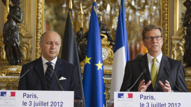 "French Foreign Minister Laurent Fabius, left, and German Foreign Minister Guido Westerwelle speak to the media during a joint press conference at the Foreign Ministry in Paris Tuesday July 3, 2012. France will host a meeting in Paris of the ""Friends of Syria"" on July 6 of countries that back the departure of Syrian President Bashar Assad. (AP Photo/Michel Euler)"