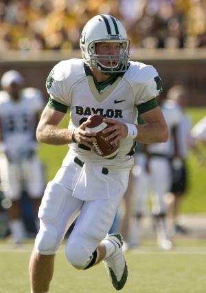 FILE - In this Nov. 7, 2009, file photo, Baylor quarterback Nick Florence tries to find an open receiver as he runs during the first quarter of an NCAA football game against Missouri in Columbia, Mo. The Baylor Bears are looking for Nick Florence to be more than a second-half fill-in for Heisman Trophy winner Robert Griffin III this season. (AP Photo/L.G. Patterson, File)