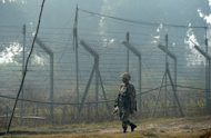 An Indian Border Security Force (BSF) soldier patrols along the border fence with Pakistan in Suchit-Garh, 36 kms southwest of Jammu, on January 10, 2013. Pakistan accused Indian troops of opening fire and killing a Pakistani soldier on Thursday, the third deadly cross-border incident reported in fivedays in the disputed Kashmir region