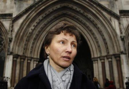 Marina Litvinenko, the wife of former KGB agent Alexander Litvinenko, leaves the High Court in London