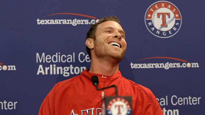 Los Angeles Angels' Josh Hamilton (32) laughs as he takes a question from a reporter during a news conference before a baseball game against the Texas Rangers Friday, April 5, 2013, in Arlington, Texas. (AP Photo/Tony Gutierrez)