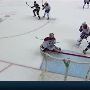 Daniel Winnik bats the puck past Tokarski