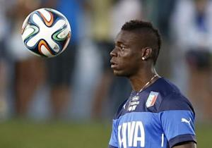 Italy's national soccer player Mario Balotelli attends a training session at the Maria Lamas Farache-Frasqueirao stadium in Natal