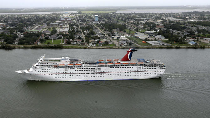 A cruise ship heads up the Mississippi River to dock in New Orleans Friday, Aug. 31, 2012. Isaac is now a tropical depression, with the center on track to cross Arkansas on Friday and southern Missouri on Friday night, spreading rain through the regions. (AP Photo/David J. Phillip)