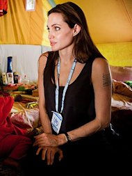 Angelin Jolie debuts a new tattoo on her arm. Photo by Jason Tanner/AP.