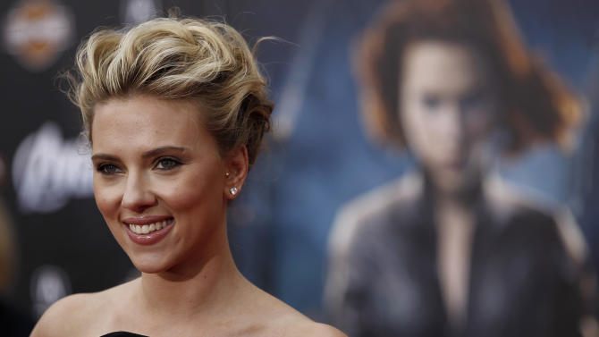 """FILE - In this Wednesday, April 11, 2012 file photo, actress Scarlett Johansson arrives at the premiere of 'The Avengers' in Los Angeles. Actress Scarlett Johansson is suing a French publishing house over a novel that uses her name and image and explores the challenges of being beautiful. The JC Lattes publishing house said Friday June 14, 2013, that a lawsuit was filed last week about Gregoire Delacourt's book """"The First Thing We Look At."""" (AP Photo/Matt Sayles, File)"""