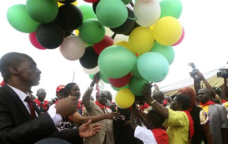 Zimbabwe's President Robert Mugabe (C) releases balloons as he celebrates his 89th birthday at Chipadze stadium in Bindura, about 90 km (56 miles) north of the capital Harare, March 2, 2013. REUTERS/Philimon Bulwayo