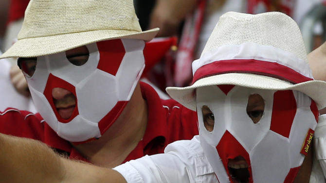 Polish fans cheer beforehe Euro 2012 soccer championship Group A match between Czech Republic and Poland in Wroclaw, Poland, Saturday, June 16, 2012. (AP Photo/Petr David Josek)