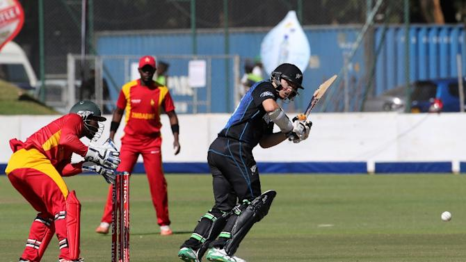 New Zealand's batsman Tom Latham (R) prepares to play a shot during the second one-day international between Zimbabwe and New Zealand at Harare Sports Club on August 4, 2015