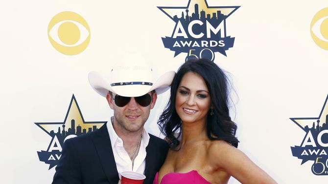 Justin Moore and Kate Moore arrive at the 50th Annual Academy of Country Music Awards in Arlington