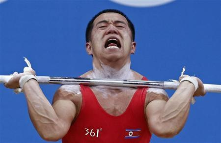 North Korea's Yun Chol Om competes on the 56Kg Group B weightlifting competition at the London 2012 Olympic Games