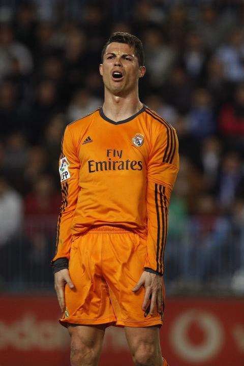 Real Madrid's Cristiano Ronaldo reacts after missing an opportunity to score against Malaga during their Spanish First Division match in Malaga