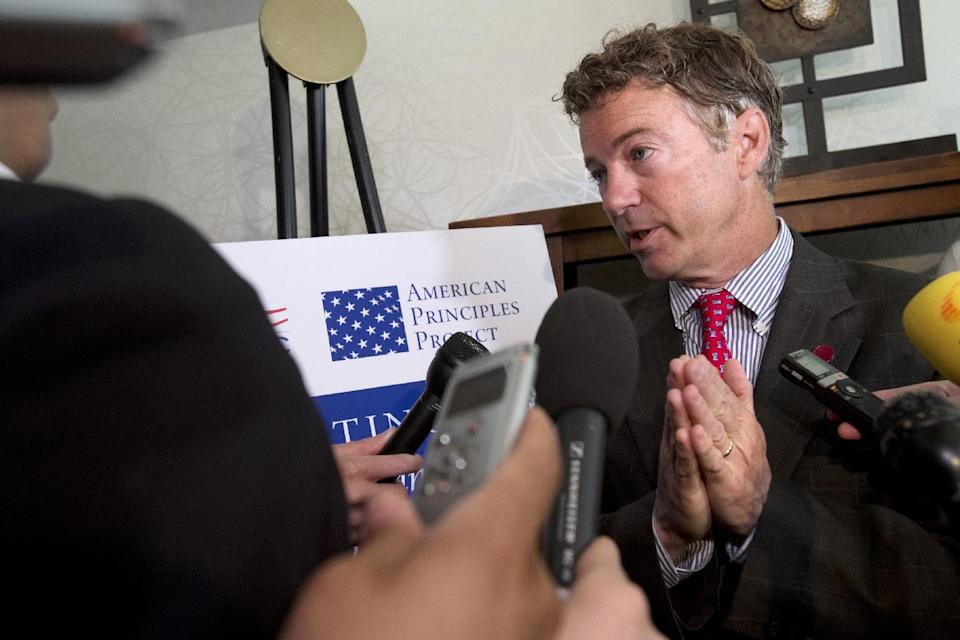 Sen. Rand Paul, R-Ky. gestures as he answers a question about immigration reform legislation after speaking at a forum on immigration organized by the Latino Partnership for Conservative Principles and the National Hispanic Christian Leadership Conference, Wednesday, June 12, 2013, at the Hyatt Regency Hotel in Washington. (AP Photo/Jacquelyn Martin)