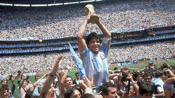 In this June 29, 1986, file photo, Diego Maradona, holds up the trophy, after Argentina beat West Germany 3-2 in their World Cup soccer final match, at the Atzeca Stadium, in Mexico City. On this day: Maradona leads Argentina to its second World Cup triumph