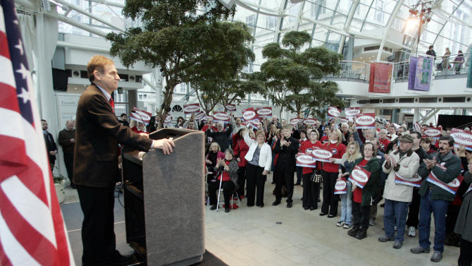 Indiana State Treasurer Richard Mourdock announces that he will be candidate for the U.S. Senate in the 2012 Republican primary during a campaign rally in Indianapolis, Tuesday, Feb. 22, 2011. (AP Photo/Tom Strattman)