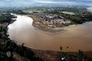 An aerial pictures shows the damge caused by devastating floods over Iligan City in the Philippines in 2011. Three children were killed and six fishermen were missing after typhoon Mawar brought heavy rains and rough waters to parts of the Philippines, the civil defence office said Monday