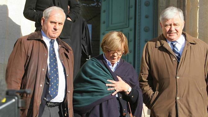 Christine de Vedrines, center, and Philippe de Vedrines, right  leave the Bordeaux court, southwestern France, Tuesday, Nov.13, 2012. Thierry Tilly,  an alleged modern-day Rasputin was convicted Tuesday of brainwashing three generations of an aristocratic French family for nearly a decade, swindling them of their fortune and their turreted manor and  was sentenced to eight years in prison by a court in Bordeaux, became a confidante of the landed Vedrines family in 2000 in a case has both riveted and shocked the nation. The de Vedrines family was so convinced of his story that they locked themselves inside their chateau for several years, terrified they would be killed. They sold off their possessions , including the family manor, and handed over euro 4.5 million ($5.7 million). Man at left is unidentified. (AP Photo)