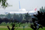 <p>A China Southern Airline plane and an Air China plane are seen taxiing for take-off at the Beijing Capital International airport, on June 7. The debt crisis in Europe and high oil prices weigh on the outlook for airlines as they meet from June 10 in Beijing for the annual meeting of the International Air Transport Association (IATA).</p>