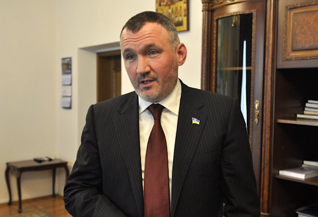 Ukraine&#39;s Deputy Prosecutor General Renat Kuzmin speaks during an interview with Associated Press in Kiev, Ukraine, Wednesday, March 14, 2012. Kuzmin charged that a firm controlled by jailed former Prime Minister Yulia Tymoshenko paid for the contract-style killing of alawmaker and businessman in 1996, further decreasing the likelihood that Tymoshenko would be released from jail any time soon. (AP Photo/Sergei Chuzavkov)