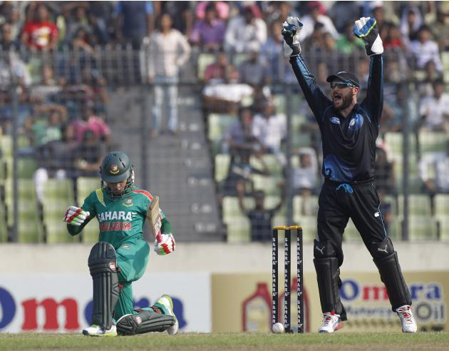 Bangladesh's captain Mushfiqur Rahim plays a shot as New Zealand's wicket keeper Brendon McCullum appeals for his dismissal unsuccessfully during their first ODI cricket match in Dhaka