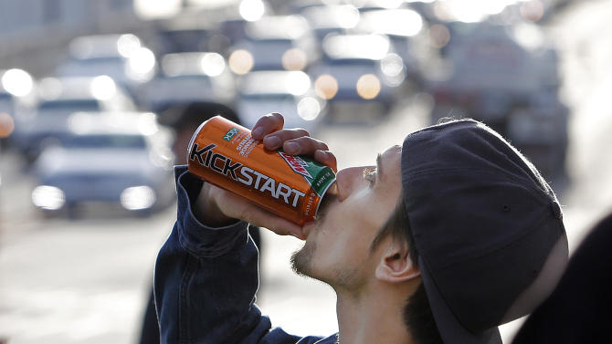 Actor Norbert Torok rehearses as the crew watches during the filming of a commercial for a new PepsiCo product called Kickstart, a carbonated drink that is part juice with Mountain Dew flavor, on the streets of downtown Los Angeles Tuesday, Jan. 29, 2013.   PepsiCo Inc. is set to roll out the new drink called Kickstart this month that has Mountain Dew flavor but is made with 5 percent juice and an extra jolt of caffeine and Vitamins B and C. The company is hoping to grow sales by reaching Mountain Dew fans at a new time of day: morning.  (AP Photo/Reed Saxon)