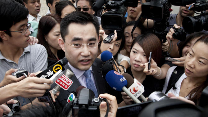 CORRECTS THE TITLE OF HE - He Zhengsheng, the family lawyer of British businessman Neil Heywood, speaks to the media upon arrival at the Hefei City Intermediate People's Court for the verdict trial of Gu Kailai, wife of ousted Chinese politician Bo Xilai, Monday, Aug. 20, 2012 in Hefei, Anhui Province, China.  The fallen Chinese politician's wife who confessed to killing Heywood is due to hear the verdict Monday in her murder trial, and Communist Party leaders may have decided against a death penalty for fear it could incite public sympathy for her.  (AP Photo/Andy Wong)