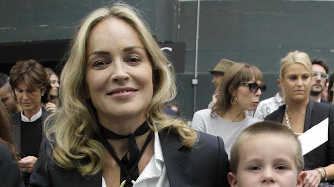 Sharon Stone and her son Quinn Kelly Stone attend the show of Belgian fashion designer Kris Van Assche for Dior as part of the Men's Spring-Summer 2013 collection, for the Paris Fashion Week, in Paris, France, Saturday, June 30, 2012. (AP Photo/Francois Mori)