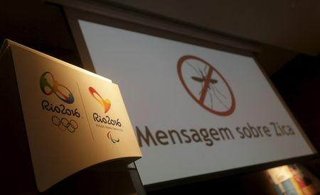 "Logos of the Rio 2016 Olympic Games and Rio 2016 Paralympic Games are pictured next to a message on a screen that reads ""Message about Zika"" during a media briefing in Rio de Janeiro"