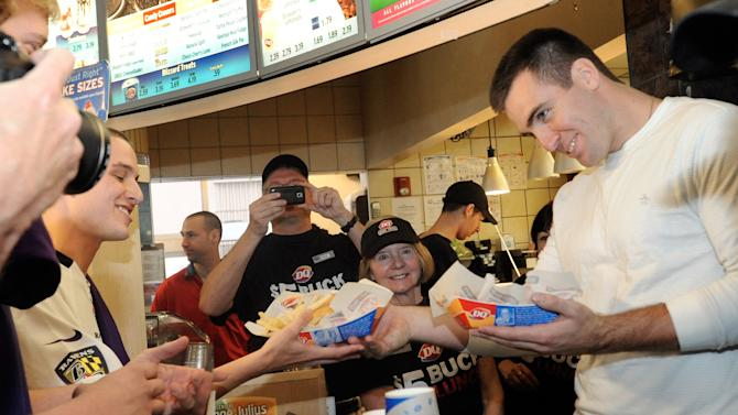 IMAGE DISTRIBUTED FOR DAIRY QUEEN - Baltimore Ravens quarterback, Super Bowl MVP and famous number five Joe Flacco serves a DQ $5 Buck Lunch at a Dairy Queen restaurant Friday, April 19, 2013 in Baltimore. Flacco visited DQ and presented a check for $25,000 to the Matthew J. Cheswick Memorial Fund, named for a Glenelg High School (Md.) student who was killed in May 2012 by a drunk driver. (Steve Ruark / AP Images for Dairy Queen)