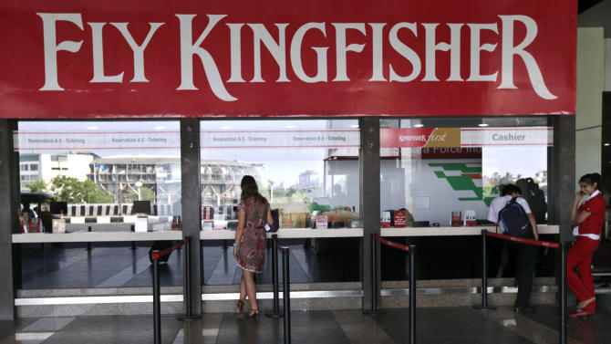 A Kingfisher Airlines booking counter lies nearly deserted in Mumbai, India, Friday, Nov. 11, 2011. Kingfisher, which is partly owned by brewery tycoon Vijay Mallya, has canceled more than 120 flights this week as pilots and crew called in sick after their October salaries were delayed. (AP Photo/ Rajanish Kakade)