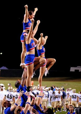 Cheerleaders and football players.
