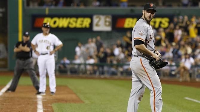 San Francisco Giants relief pitcher George Kontos, right, looks back towards home plate after being ejected for hitting Pittsburgh Pirates' Andrew McCutchen in the eighth inning of the baseball game on Tuesday, June 11, 2013, in Pittsburgh. The Pirates won 8-2. (AP Photo/Keith Srakocic)