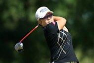 Jiyai Shin of South Korea hits her tee shot on the 11th hole during the final round of the Kingsmill Championship at Kingsmill Resort in Williamsburg, Virginia. Shin beat Paula Creamer with a par at the ninth hole of sudden-death, winning the Kingsmill Championship in the longest playoff involving two players in LPGA history