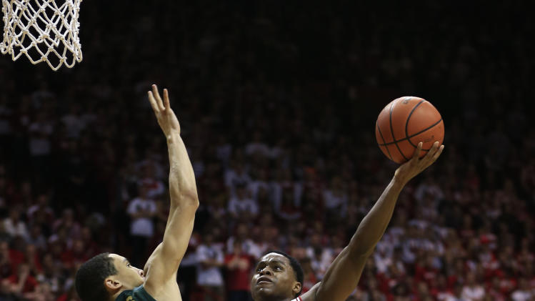 Indiana's Yogi Ferrell (11) shoots against Michigan State's Travis Trice (20) during the second half of an NCAA college basketball game on Sunday, Jan. 27, 2013, in Bloomington, Ind. Indiana defeated Michigan State 75-70. (AP Photo/Darron Cummings)