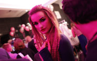 A model walks backstage before the Betsey Johnson Spring 2013 collection show during Fashion Week, Tuesday, Sept. 11, 2012, in New York. (AP Photo/Jason DeCrow)